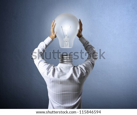 idea concept, lamp head businessman - stock photo