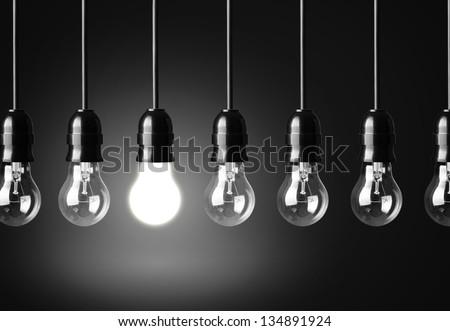 Idea concept on black background - stock photo