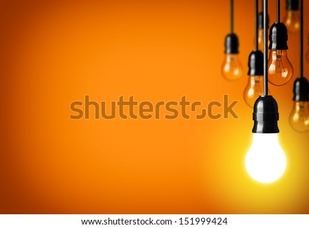 Idea concept on orange background.  - stock photo