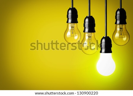 Idea concept on yellow background. - stock photo