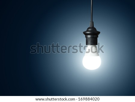 Idea concept, single modern light bulb over blue background with copy space - stock photo