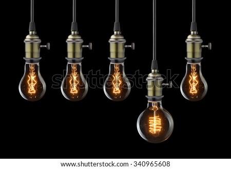 Idea concept. Vintage light bulbs on black - stock photo