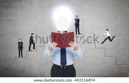 Idea concept with bulb headed businessman reading book and other businessmen climbing abstract stairs in the background - stock photo