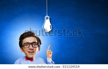 Idea concept with businessman with big head and light bulb hanging above  - stock photo