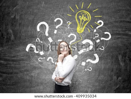 Idea concept with businesswoman standing against wall with question mark and bulb sketch - stock photo