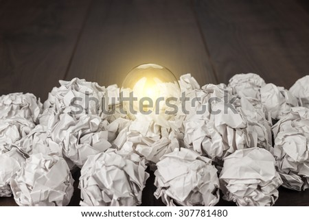 idea concept with crumpled office paper and light bulb - stock photo