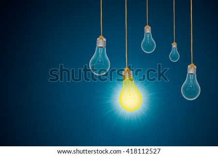 Idea concept with light bulbs on blue background, 3d rendering