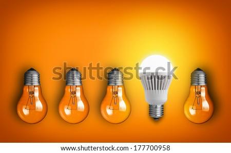 Idea concept with row of light bulbs  - stock photo