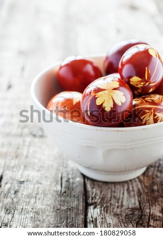 Idea for Decoration of Easter Eggs using Fresh Plants and Onions Peels - stock photo