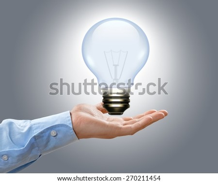 Idea. Ideas bulb light on a hand - stock photo