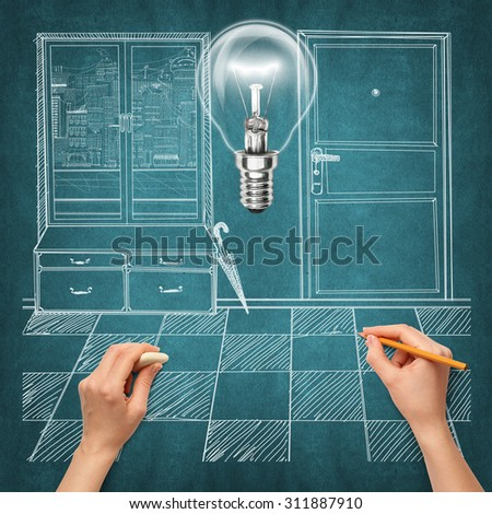 Idea interior background with lamp, sketch and human hand with pencil - stock photo