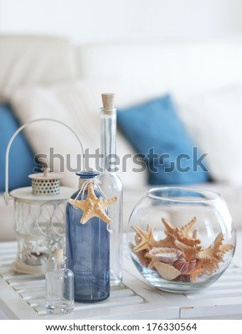 Idea of interior decoration with starfishes and glass bottles - stock photo