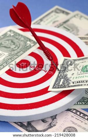 Idea of ???making profit - dart hit at dollar, close-up - stock photo