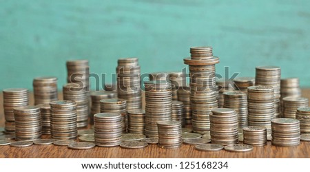 idea of materialism - city made of coins - stock photo