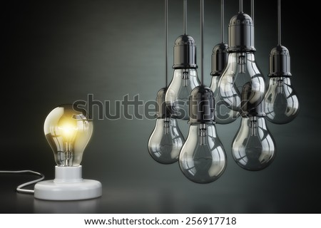 Idea or leadership concept. Group of lightbulbs on the black background. 3d - stock photo