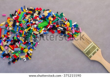 idea splash with paint brush and plastic block toy Creative concept.jpg - stock photo
