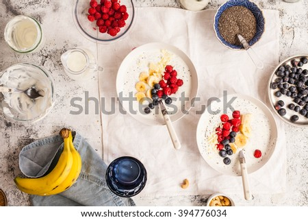 Ideal acai coconut yogurt bowl concept. Detox and healthy breakfast bowl. Top view. - stock photo