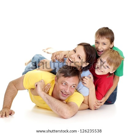 Ideal family in bright T-shirts on a white background - stock photo