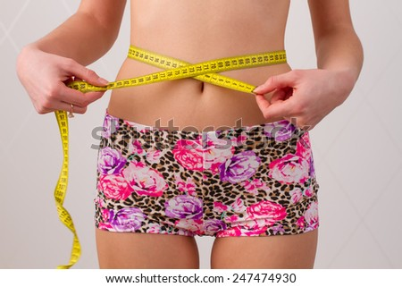 ideal waist size for advertising - stock photo