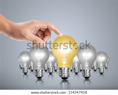 Ideas bulb light in a hand