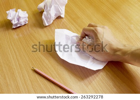 Ideas,Crumpled paper on wooden table - stock photo