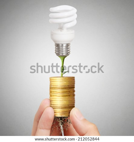 Ideas, energy saving light bulb coins  - stock photo