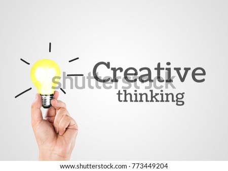 Ideas For Success. Light bulb Thinking Creative. Hand pick up lamp thinking symbol.