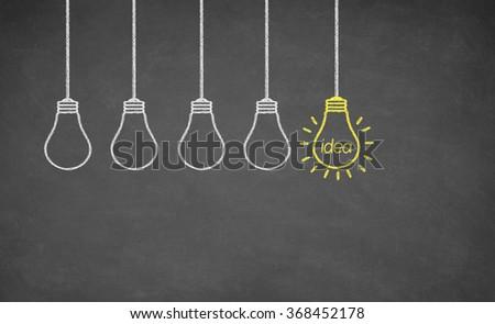 Ideas Light Bulb Concept Work on Blackboard - stock photo