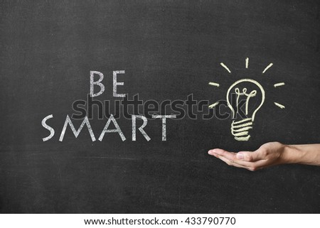 Ideas Light Bulb Concept Work on Blackboard and male hand. Text Be Smart