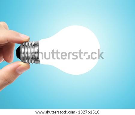 Ideas light bulb on a hand - stock photo