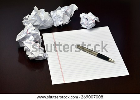 Ideas to be written down on blank sheet of paper crummpled sheets and pen - stock photo