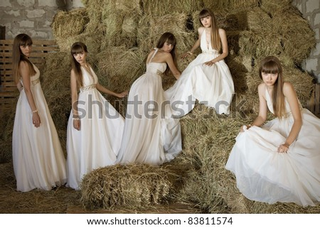 identical five twins in the hay. rural portrait