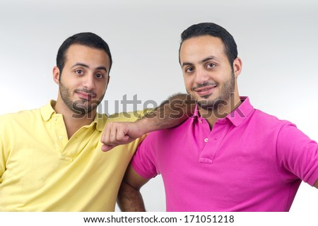 Identical twins portraits shot isolated