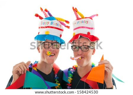 Identically adult male twins having birthday in studio - stock photo
