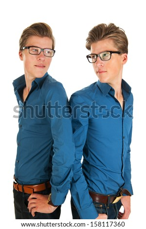 Identically adult male twins in studio - stock photo
