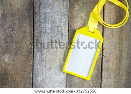 Identity card on wooden table - stock photo