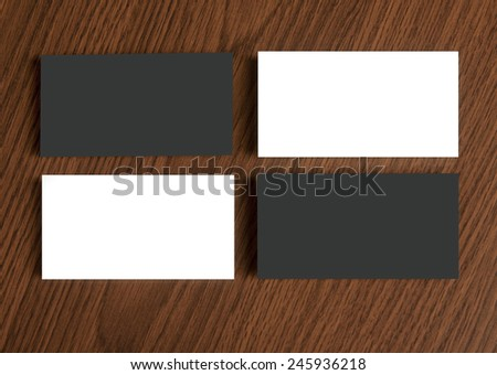 identity design, corporate templates, company style, blank business cards with clip on a wooden background - stock photo