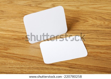 identity design, corporate templates, company style, blank business cards with rounded corners on a wooden background - stock photo