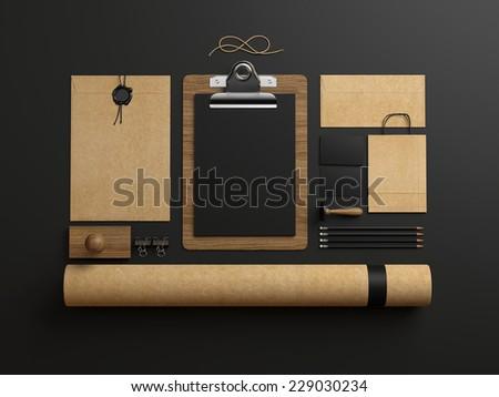 identity elements on dark paper background - stock photo