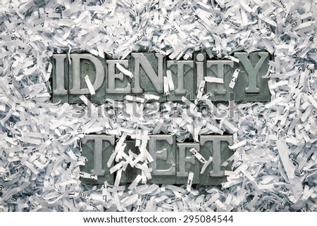 identity theft phrase made from metallic letterpress type inside of shredded paper heap - stock photo