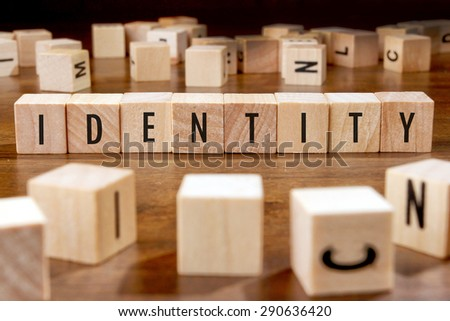 IDENTITY word written on wood block - stock photo