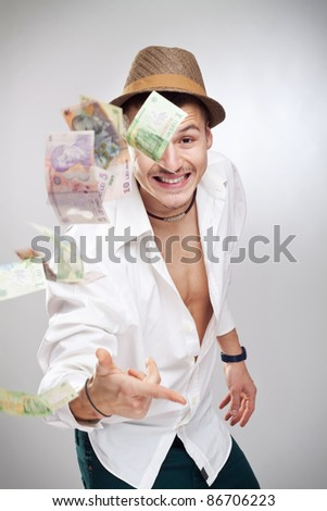 idiot player wannabe throwing money in the air - stock photo