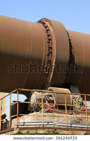 idle cement plant rotary kiln machinery, closeup of photo