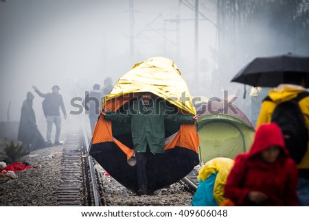 Idomeni, Greece. 22 April 2016. 14.000 refugees stuck in Greek borders as FYROM has closed the borders.The weather is bad with cold and rain. People are sick 7000 children and there is not enough food