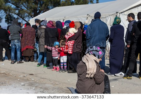 Idomeni, Greece, February 7, 2016: Hundreds of immigrants are in a wait at the border between Greece and FYROM  waiting to cross the borders to FYR of Macedonia