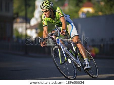 IDRIJA, SLOVENIA - june, 21. 2013: Kristjan Koren from team Cannondale winning ride during the Kriterij - Idrija cycling race through the roads of IDRIJA. - stock photo