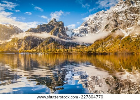 Idyllic autumn scene in the Alps with mountain lake reflection in beautiful morning light - stock photo