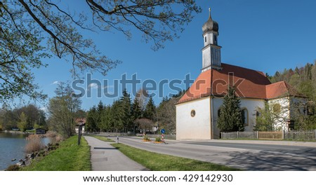idyllic bavarian chapel with onion dome, lakeside tegernsee, upper bavaria