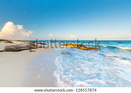 Idyllic beach of Caribbean Sea at sunrise, Mexico - stock photo