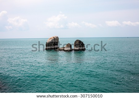 Idyllic blue sea and clear sky and stand-alone rocks. Taken in Koh Samui, Thailand - stock photo